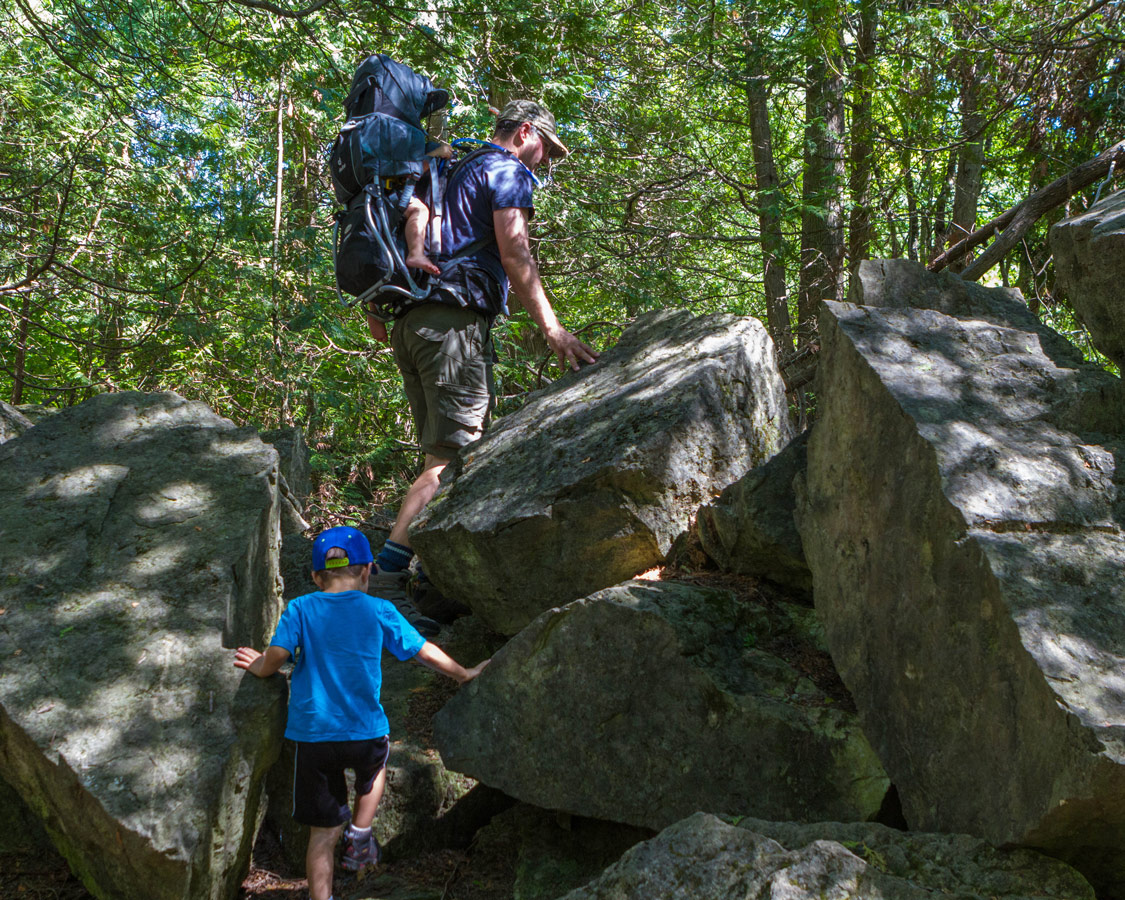boys-climb-large-rocks-near-the-lime-kiln-at-Limehouse-Conservation-Area-in-Ontario