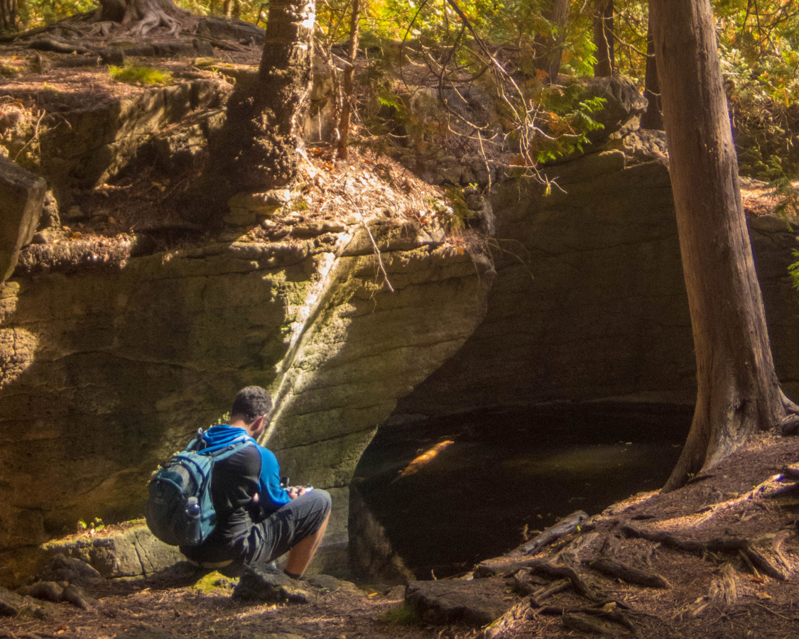 Kevin-sits-near-the-top-of-the-Limehouse-Conservation-Area-crevasses-in-Ontario