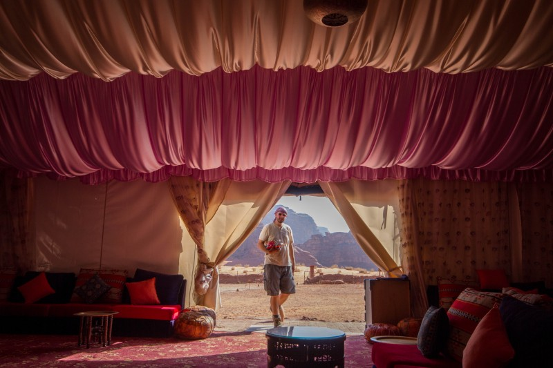 Dramatic drapery of a bedouin tent with a man standing at the entrance in the Wadi Rum Desert