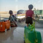 Two boys watch a Royal Jordanian plane from Toronto Pearson Airport