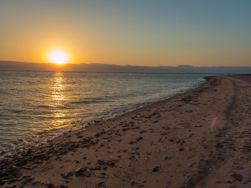 View Red Sea beach during the sunset in Aqaba Jordan.