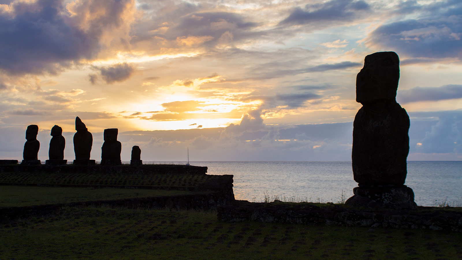 Moai are silhouetted by the sunset on Easter Island