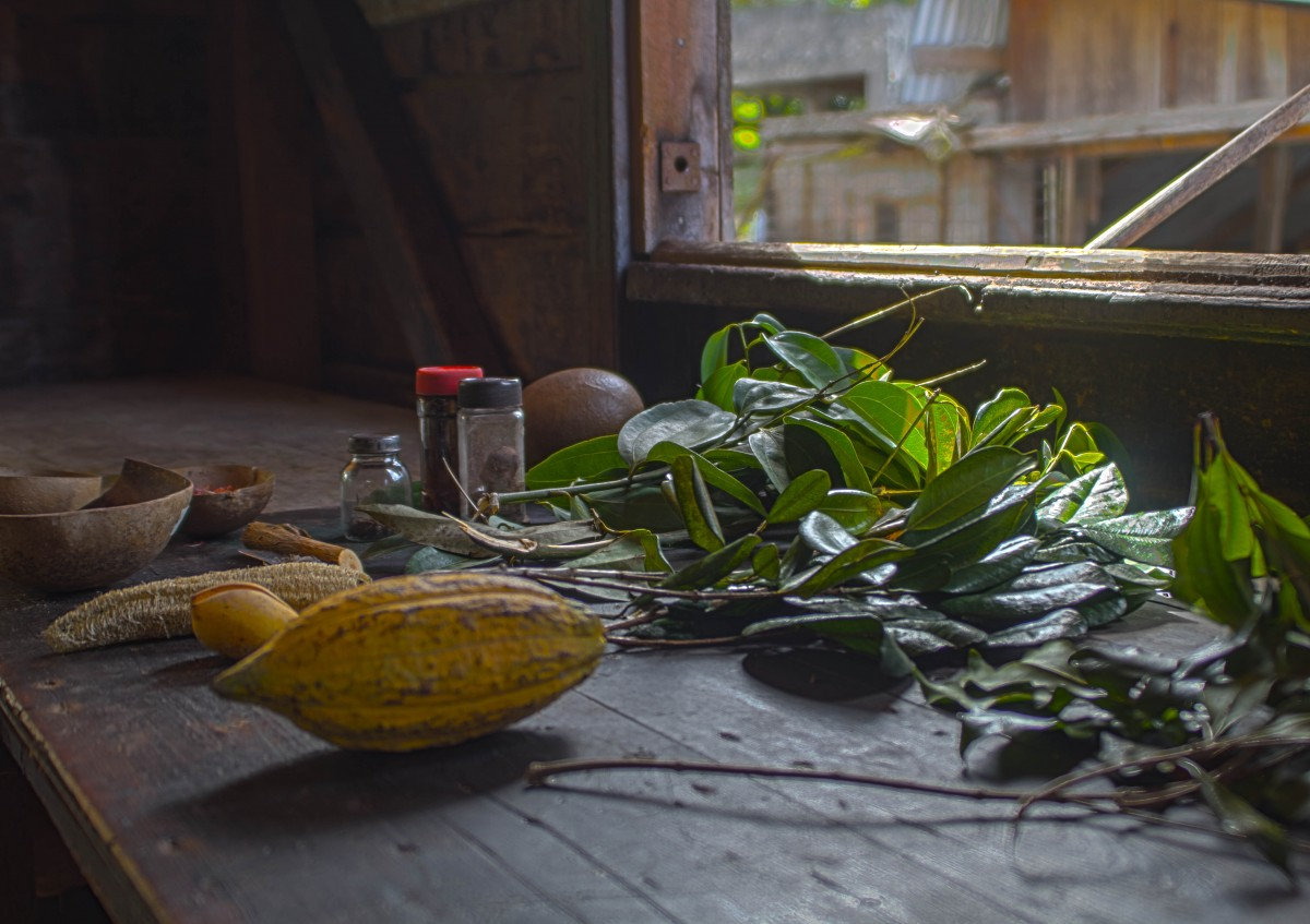 Spices cocoa and herbs on a wooden table in Grenada