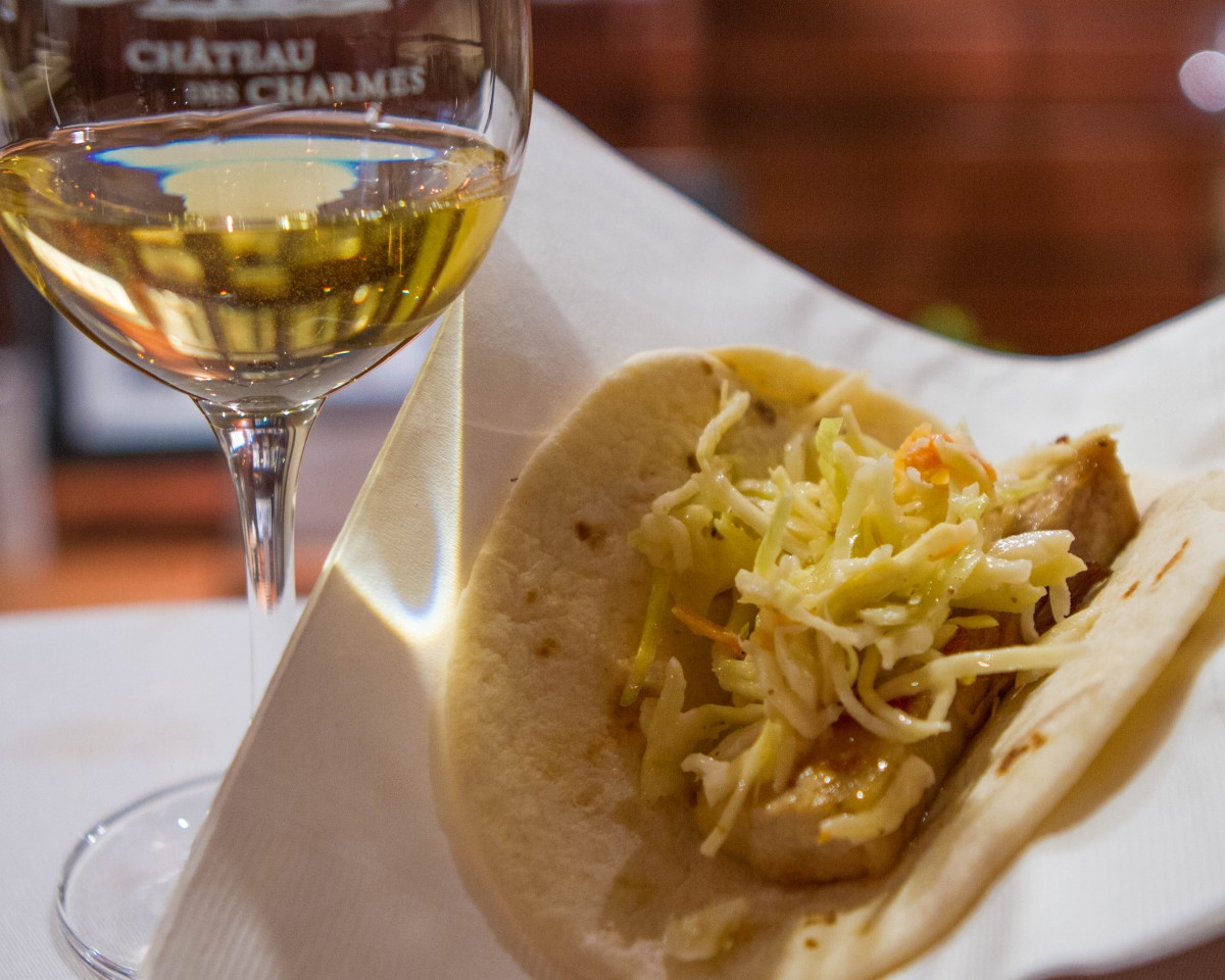 Glass of Chateau des Charmes icewine served with pork belly taco at Chateau des Charmes winery in Niagara-on-the-Lake during the Niagara Icewine Festival