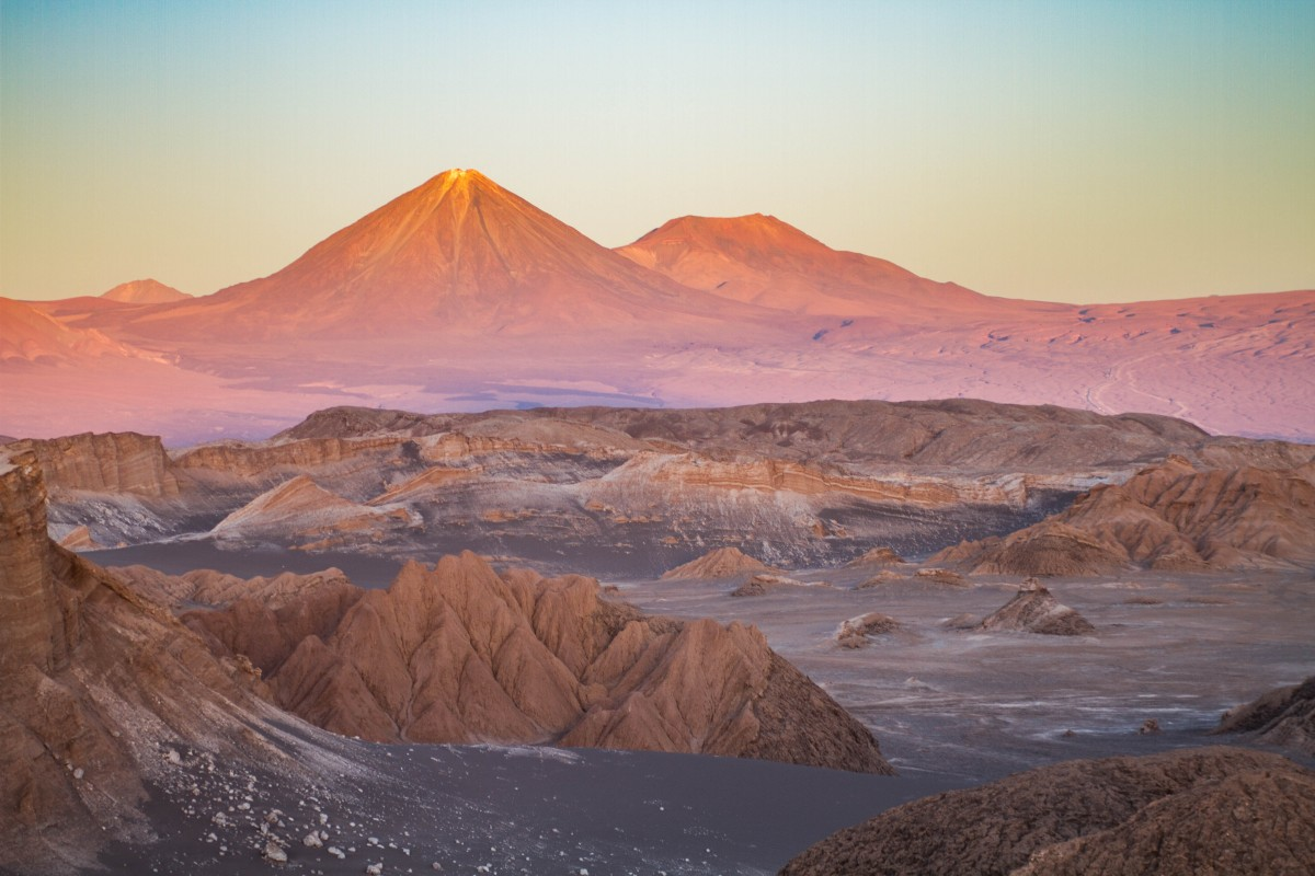 Sunset make the colours of the Atacama Desert explode with the Andes mountain range in the backdrop