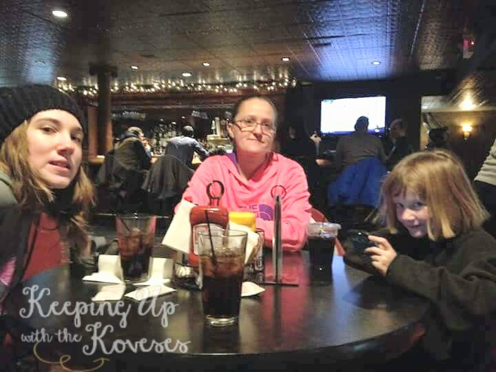 Family enjoys hot drinks at a coffee shop - Skiing North Michigan