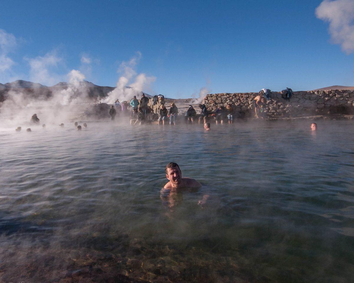 Man in natural hot spring in El Tatio Geyser in Chile.