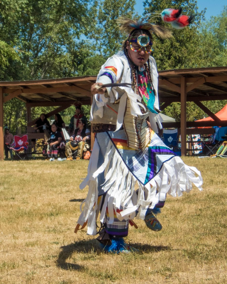 Man in regalia dancing at the Sheguiandah First Nation Traditional Pow Wow on Manitoulin Island.