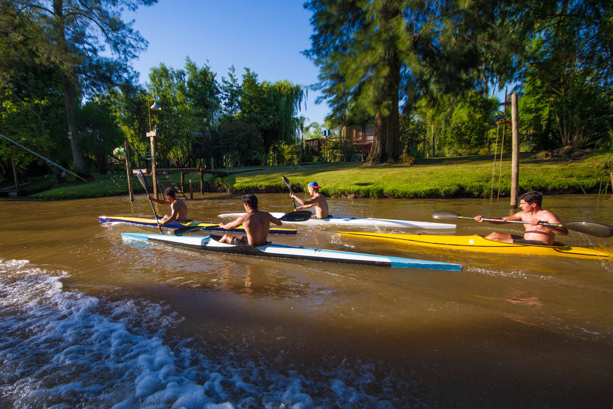 Kayakers race along the Delta Parana in Tigre, Argentina