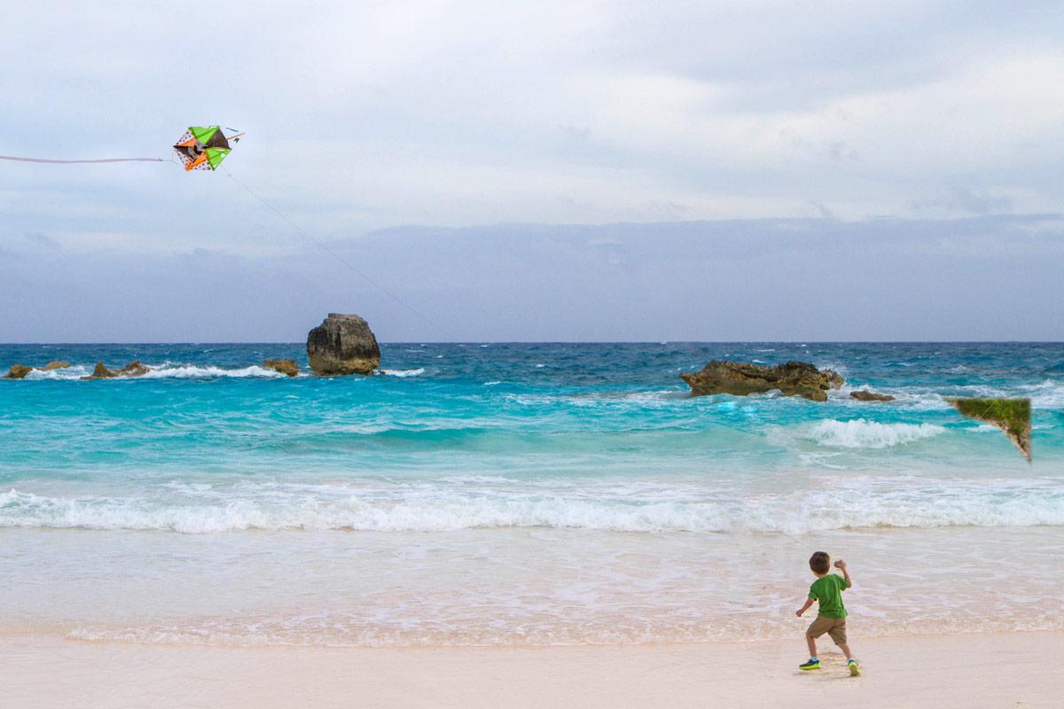 A young boy flies a homemade kite at Horseshoe Bay Beach in Bermuda