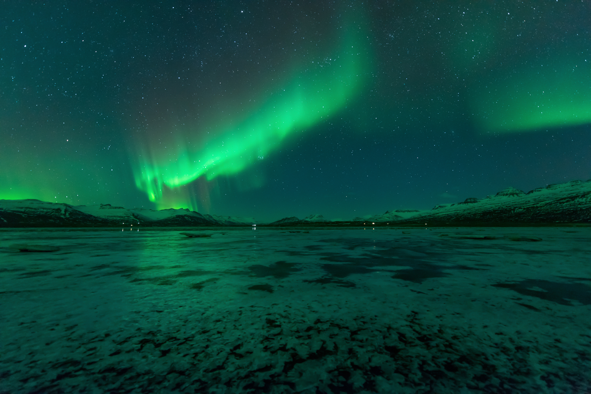 green sheets of aurora borealis shine over Great Slave Lake in the Northwest Territories