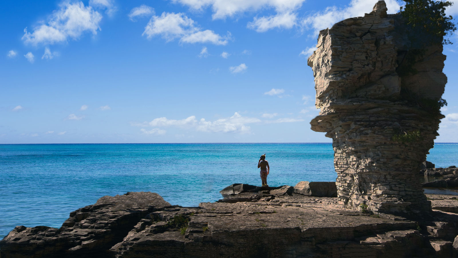Boy with snorkel on Flowerpot Island at Fathom Five National Marine Park.