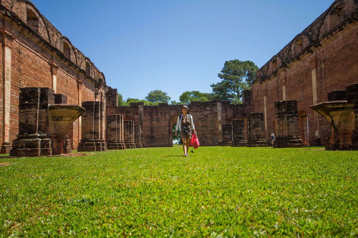 Woman wandering through the ruins of the Jesuit ruins of Jesus de Tavarrangue in Paraguay