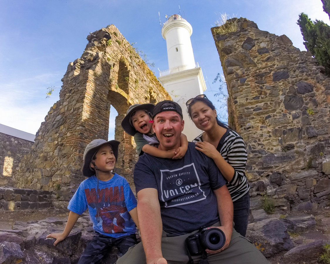 Family poses inside the San Francisco convent ruins in Colonia del Sacramento, Uruguay.