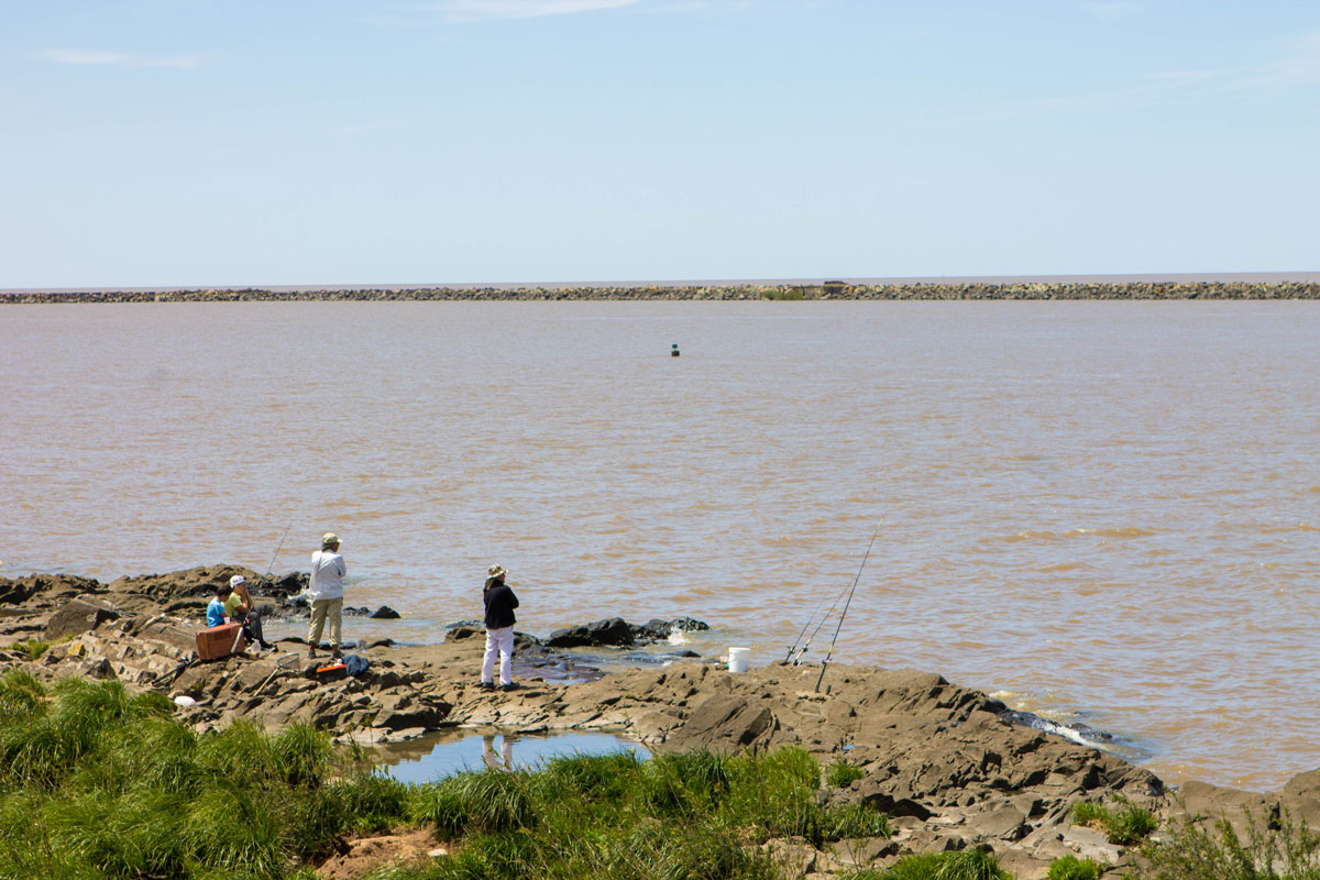 Fisherman fishing on the Rio de la Plata off of Colonia del Sacramento, Uruguay.