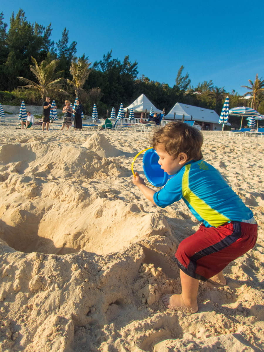Boy playing in the sand at East Whale Bay, Bermuda.