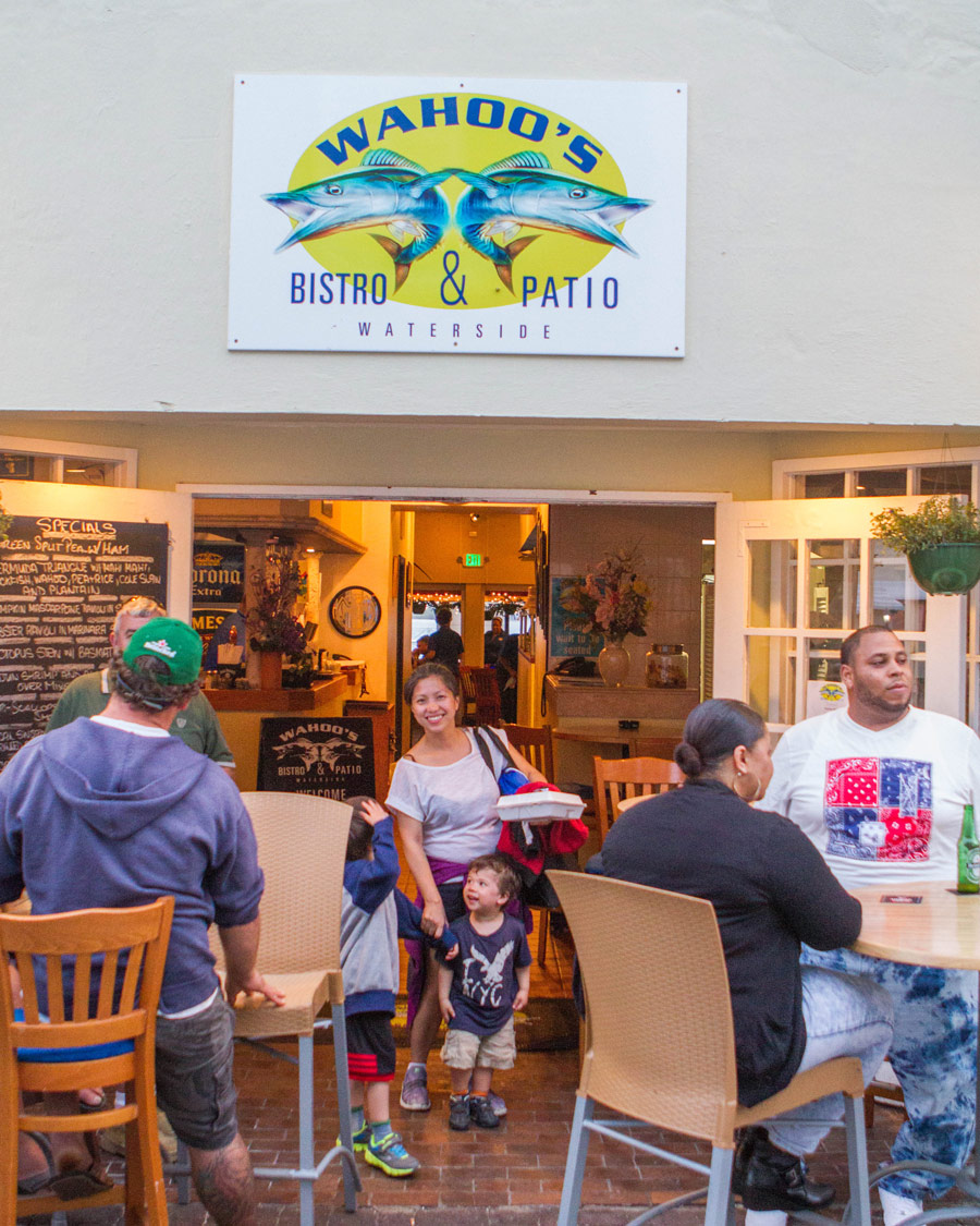Woman leaving Wahoo Bistro and Pub in St. George Bermuda