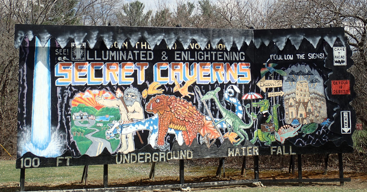 One of the famous hand drawn billboards you drive by on your way to Secret Caverns New York.