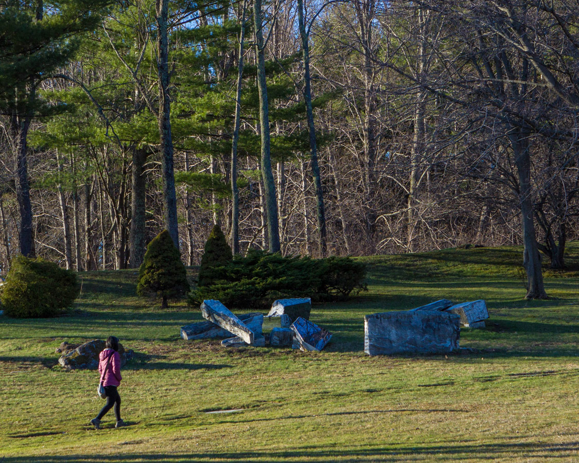 Lady walking on a path at the Wilburton Inn enjoying the art installations on the way to the Museum of Creative Process.