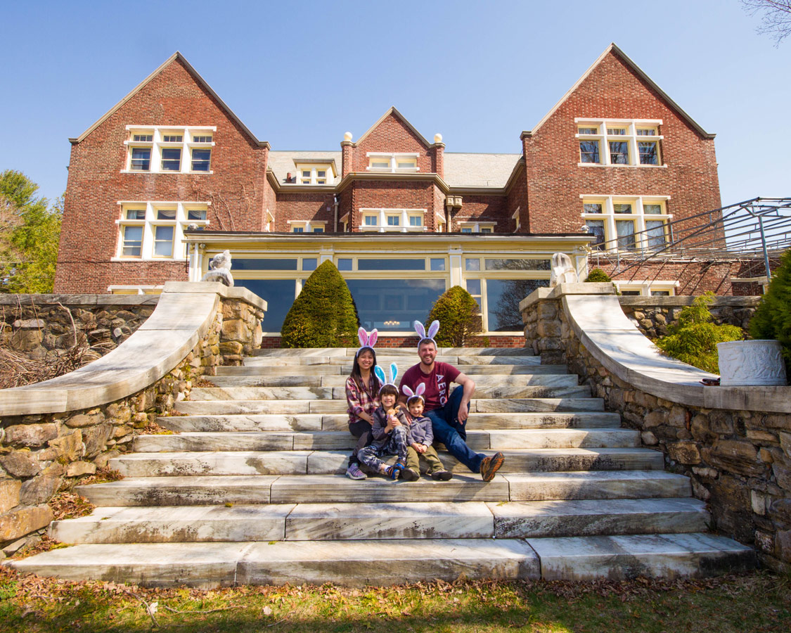 Families sits on the grand staircase going out into the backyard of the Wilburton Inn.