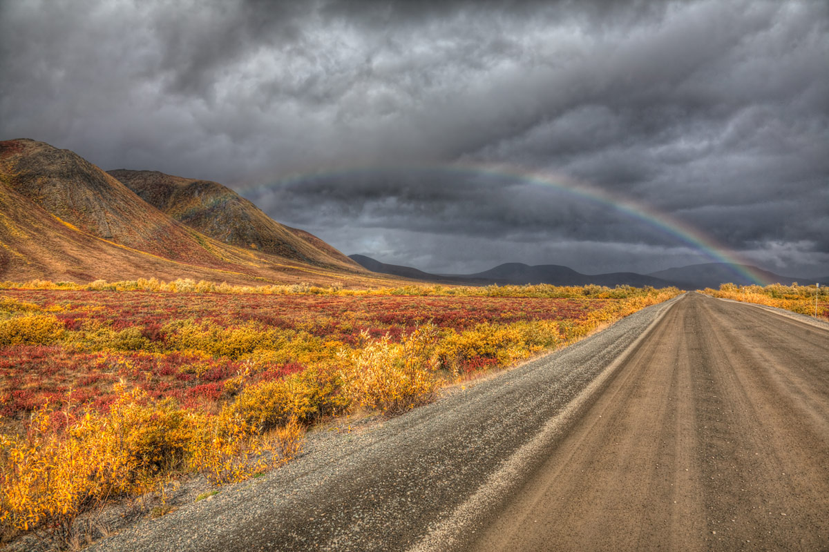 A rainbow and stormy clouds along the Dempster Highway in the Northwest Territories one of the most amazing places in Canada
