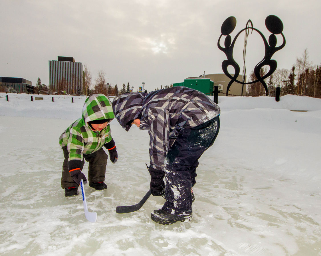 Children playing ice hockey in Yellowknife Northwest Territories one of the most amazing places in Canada