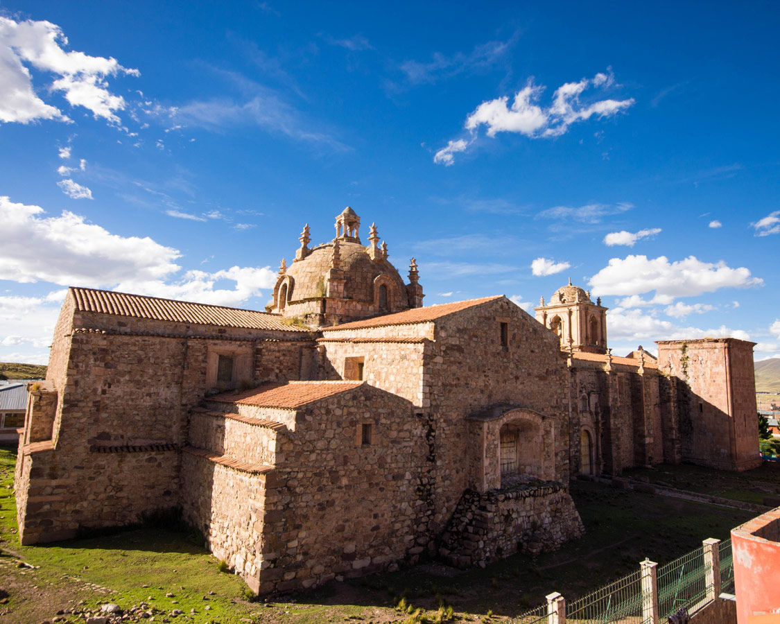 Church adorned with bull frescoes and statues in Pukara Peru on the Cusco to Puno bus in Peru