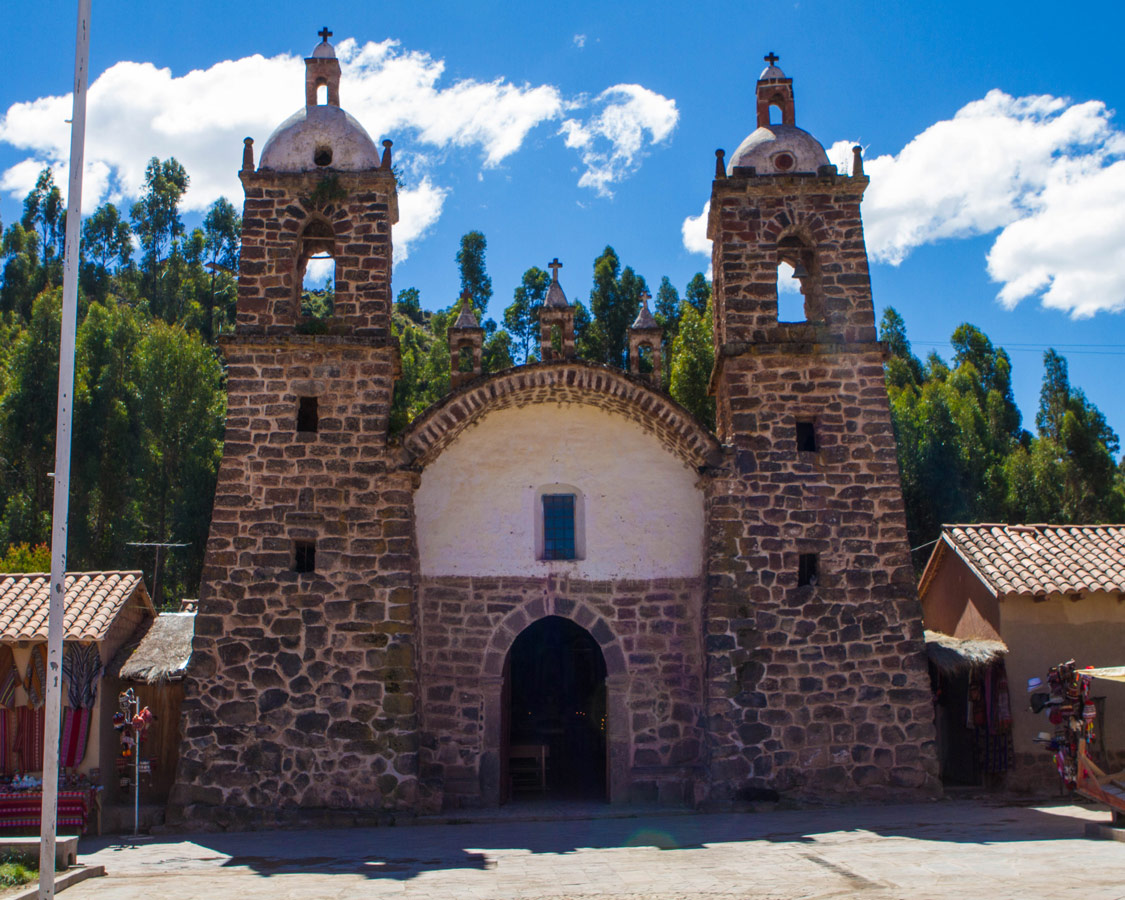 A stone and adobe baroque church in Raqchi Peru. It is seen during the Cusco to Puno bus tour with Inka Express