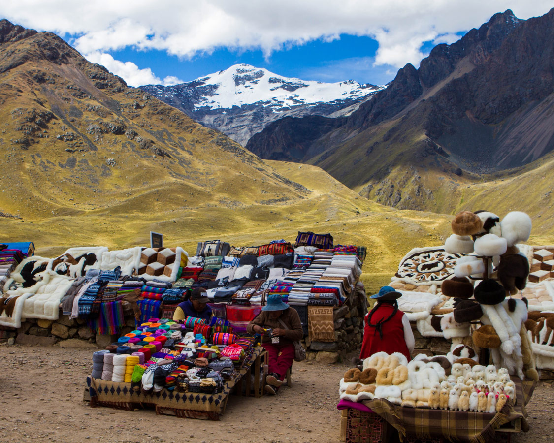 Local Quechua women sell handicrafts at a market in Abra la Raya Peru along the Cusco to Puno bus tour in Peru