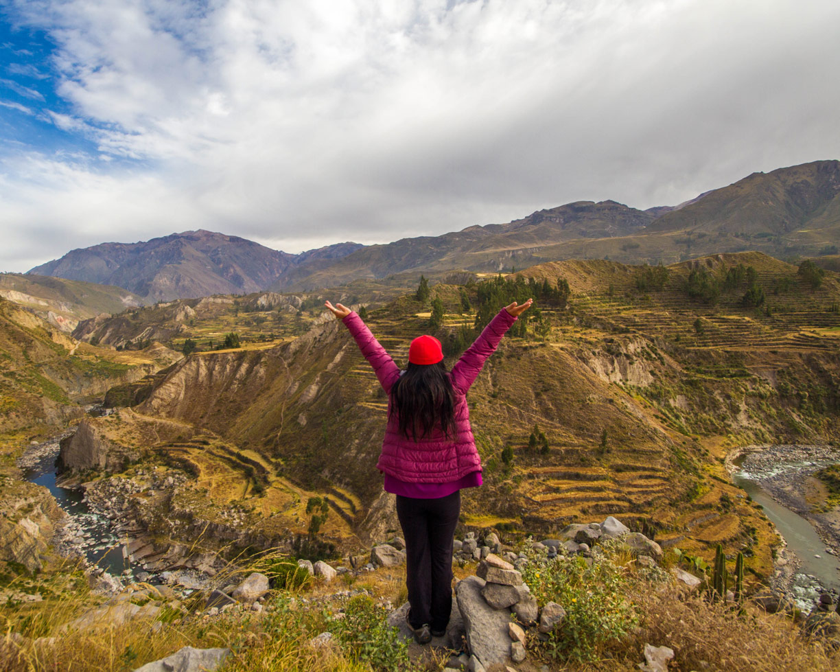 Christina Wagar celebrates the view at Colca Canyon Peru as we prepare to view the Andean Condors in Colca Canyon with kids