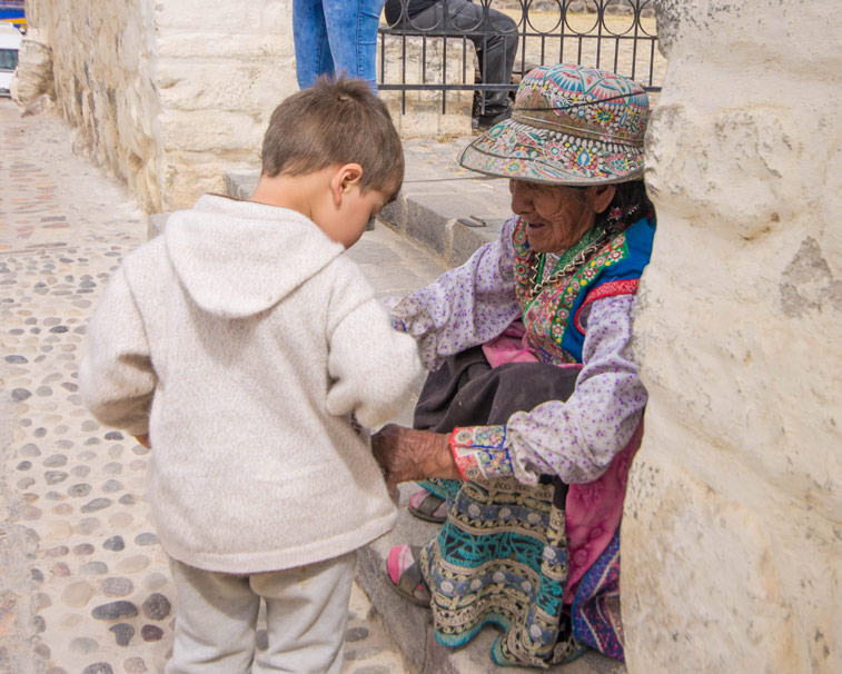 D meets a local Collagua woman on his way to see the Andean Condors in Colca Canyon with kids