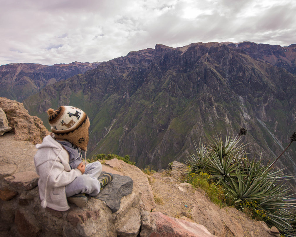 D of the Wandering Wagars looks out over Colca Canyon Peru waiting to view the Andean Condors in Colca Canyon with kids