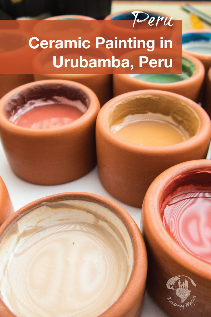 Clay pots filled with traditional paints at the ceramics painting with kids workshop at Ceramica Seminario in Urubamba Peru