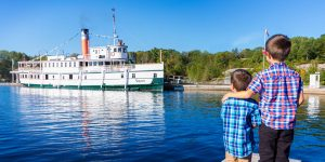 Watching the RMS Seqwun of the Lake Muskoka Steamships in Gravenhurst Ontario during a Lake Muskoka Steamship Cruise