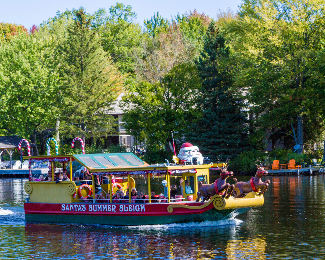 Santas boat from Santas Village in Bracebridge Ontario seen from a Lady Muskoka boat cruise on the Muskoka river