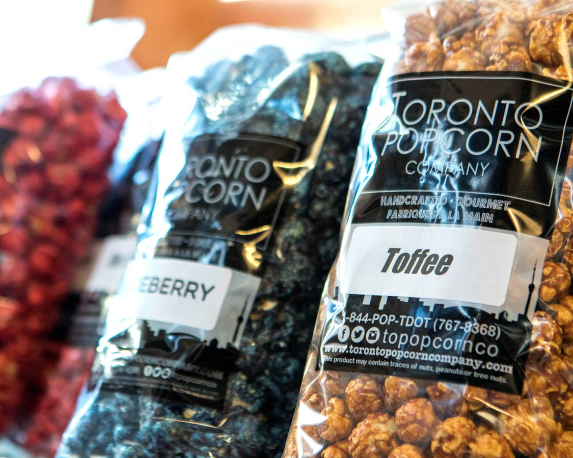 Bags of flavoured popcorn from the Toronto Popcorn Company in Kensington Market on a Toronto Food Tour with Tasty Tours Toronto