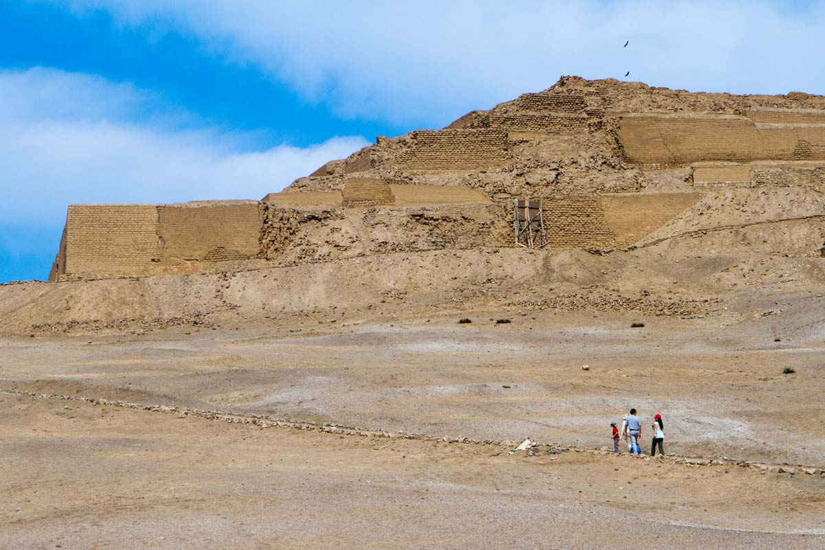 Christina and the boys walking towards the Temple of the Sun in Pachacamac Peru for family travel