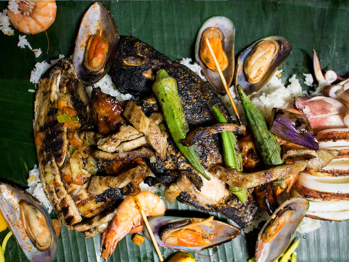 Filipino hand to mouth meal at Tunino restaurant in Toronto Ontario