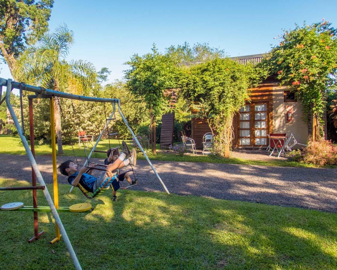 Children play on a swingset at Brizas del Norte hotel in San Ignacio Argentina