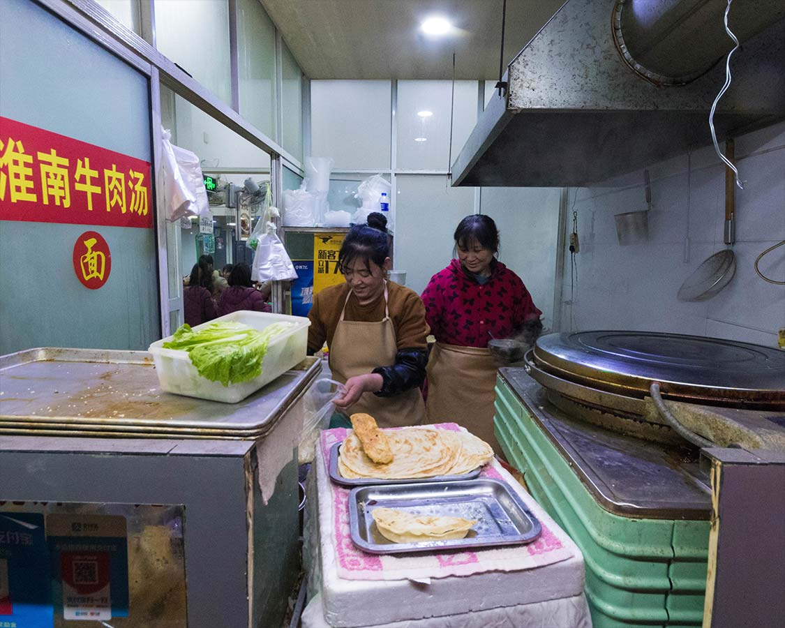 Cooks prepare Chinese soup at a restaurant in Shanghai China