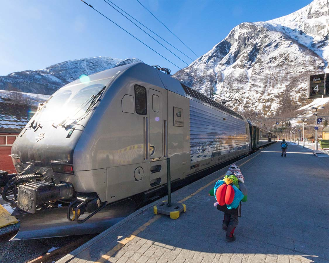 Norway winter travel children board the Flamsbana train in Flam