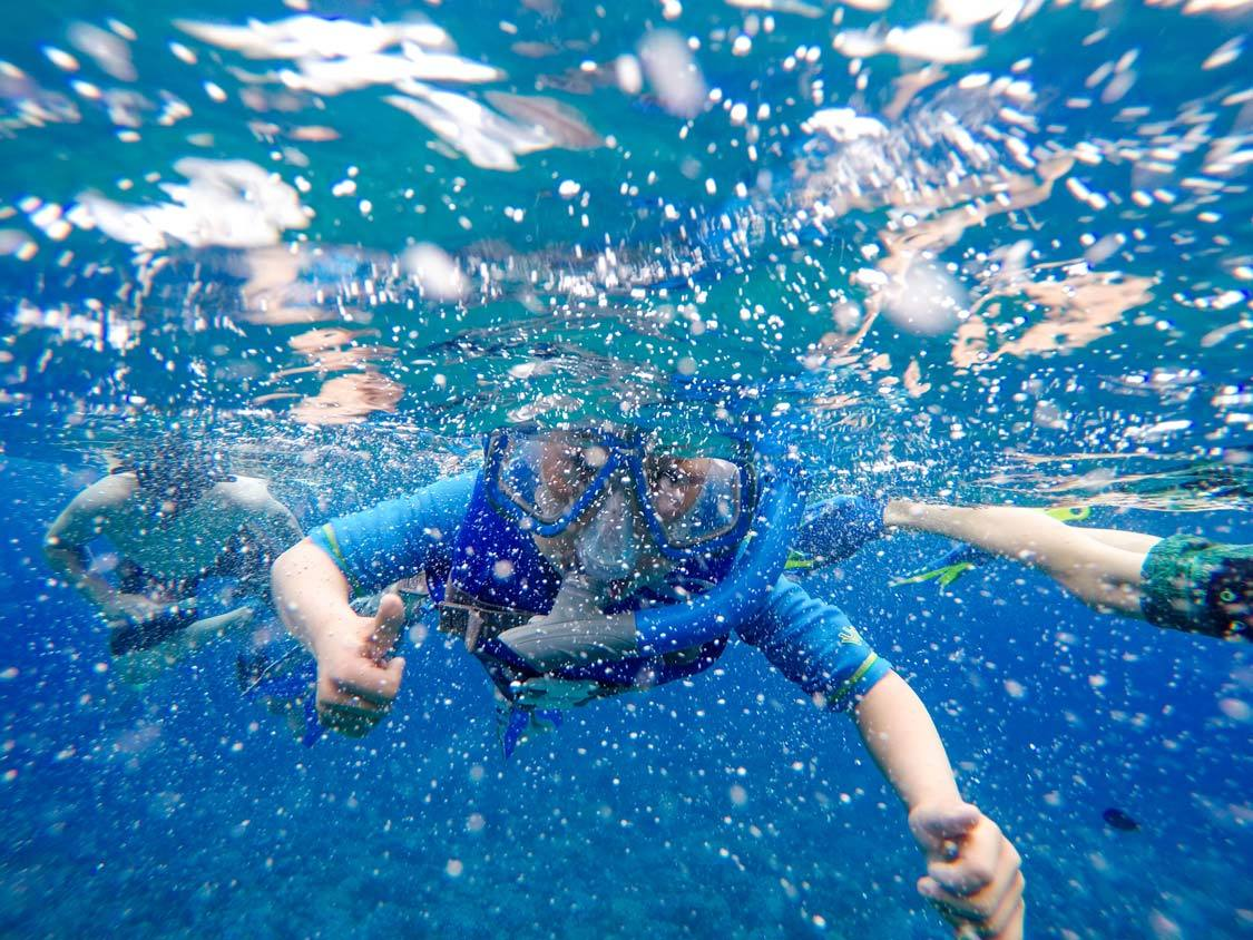 Young Boy learning to snorkel in Maui Hawaii