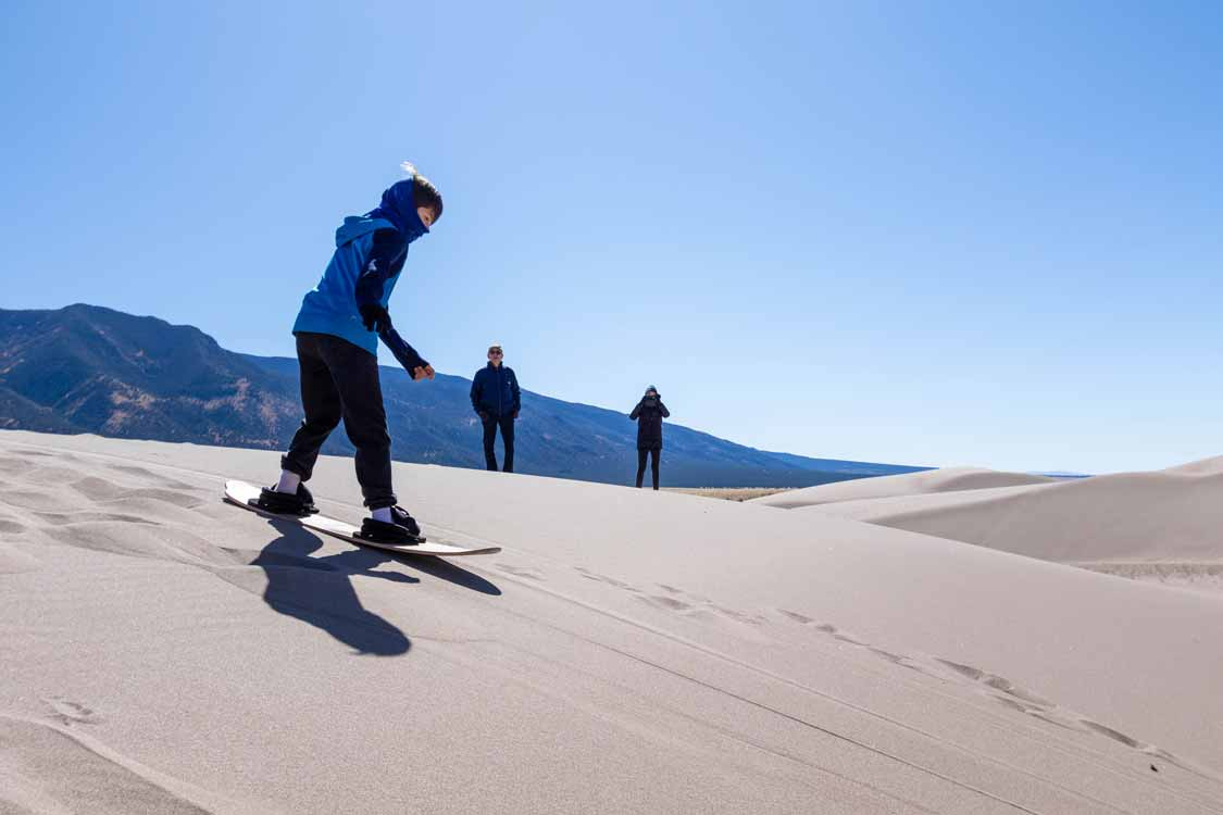 Sandboarding in Great Sand Dunes National Park with kids