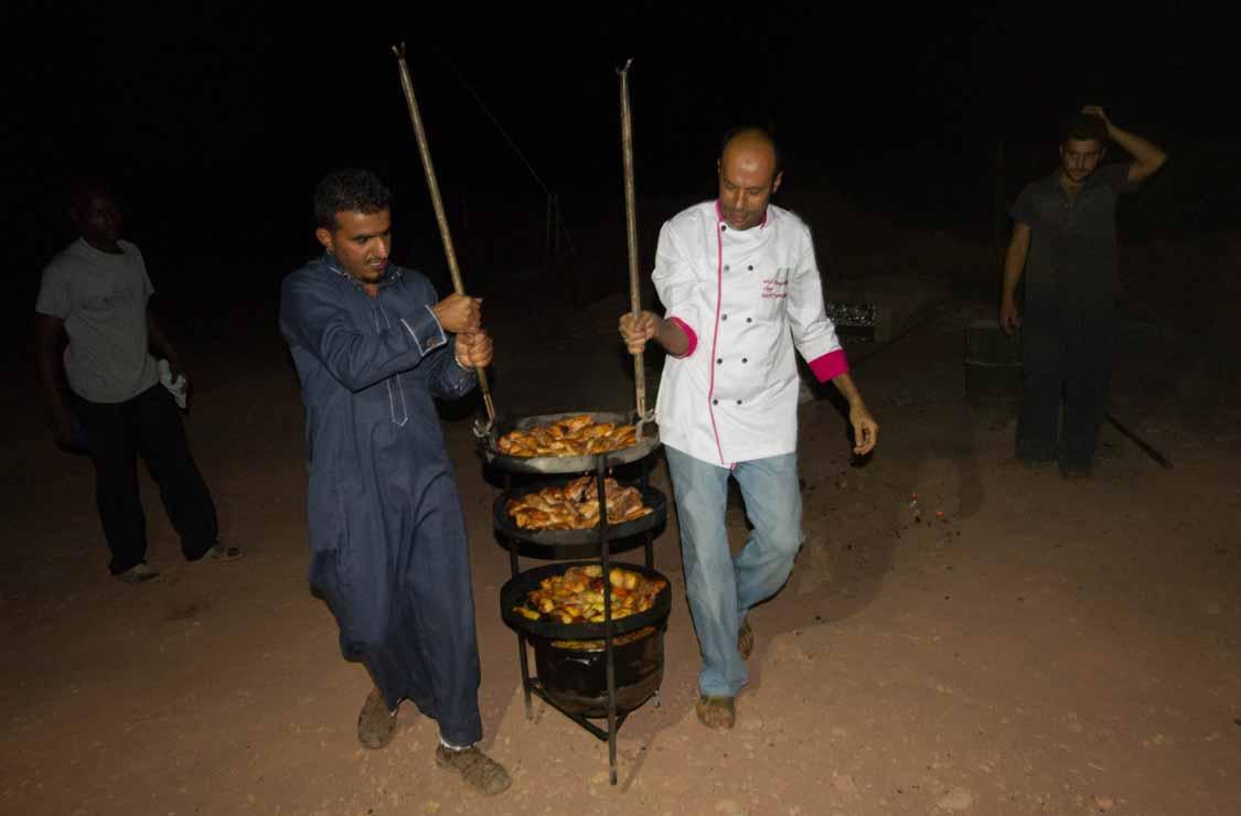 Jordanian Zarb cooking by Bedouins in Wadi Rum