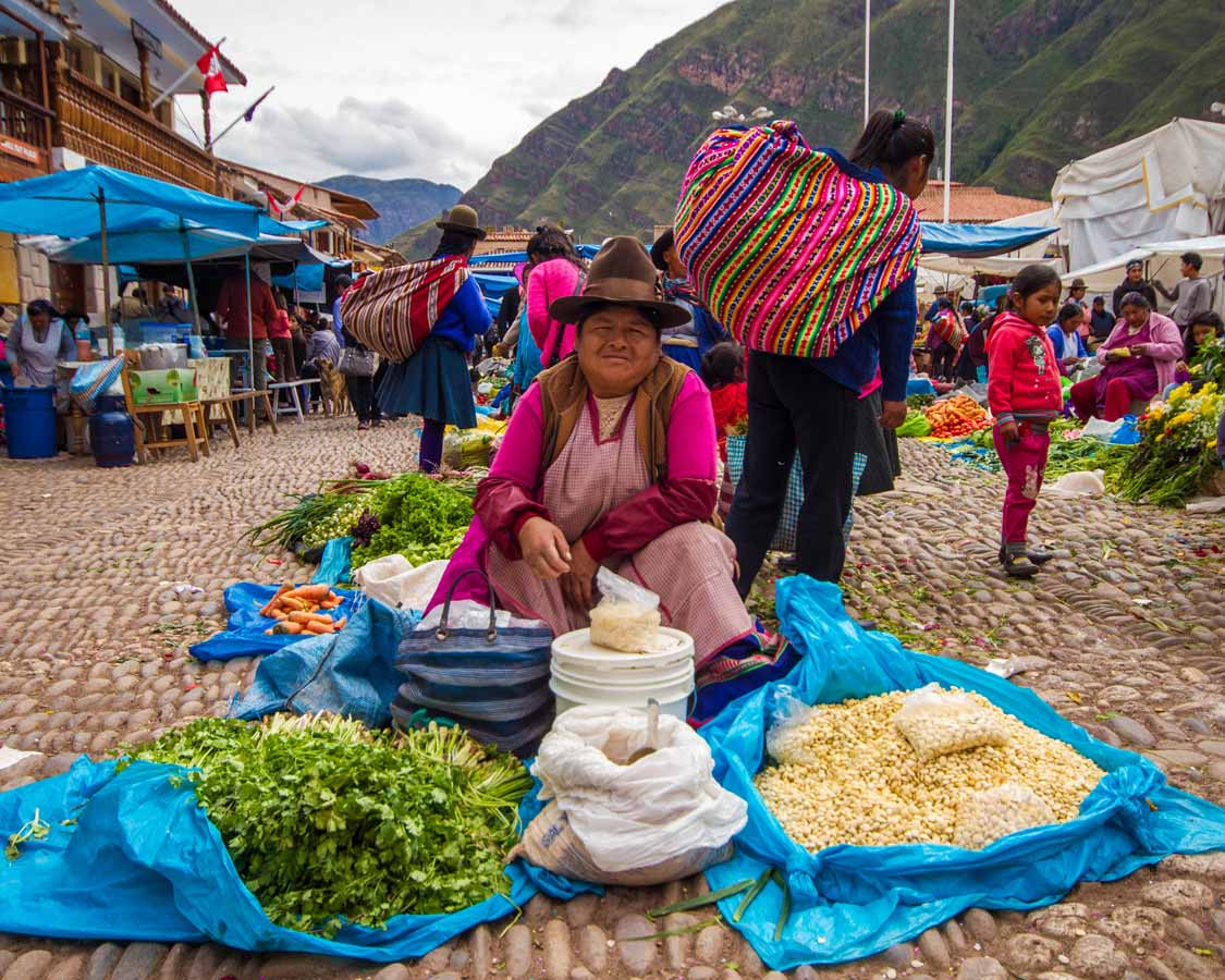 Guarani vendor selling simple Peruvian recipes at a market in Pisac