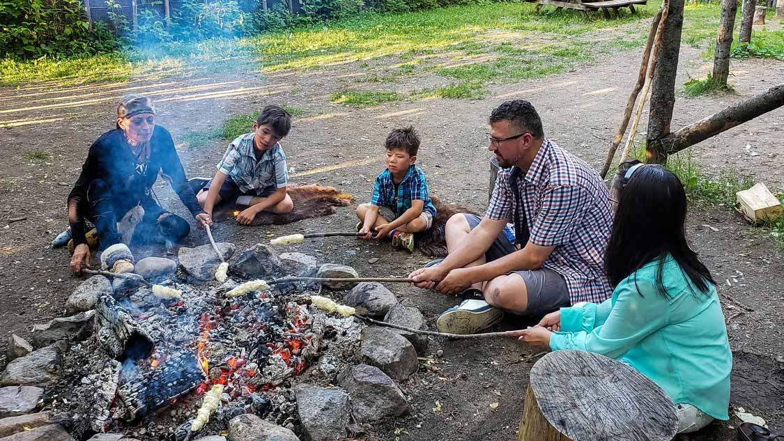 Cooking Indigenous bannock-over a fire in Wendake Quebec