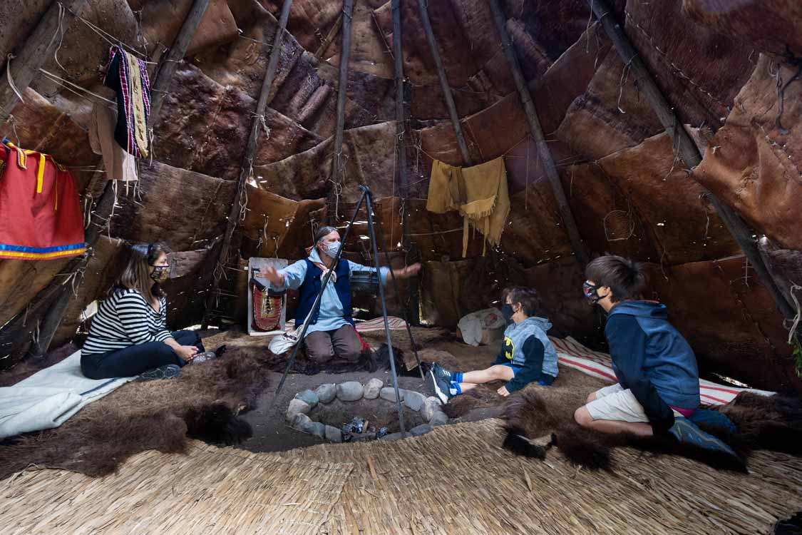 Storytelling inside a wigwam at Fort Williams Historic Park