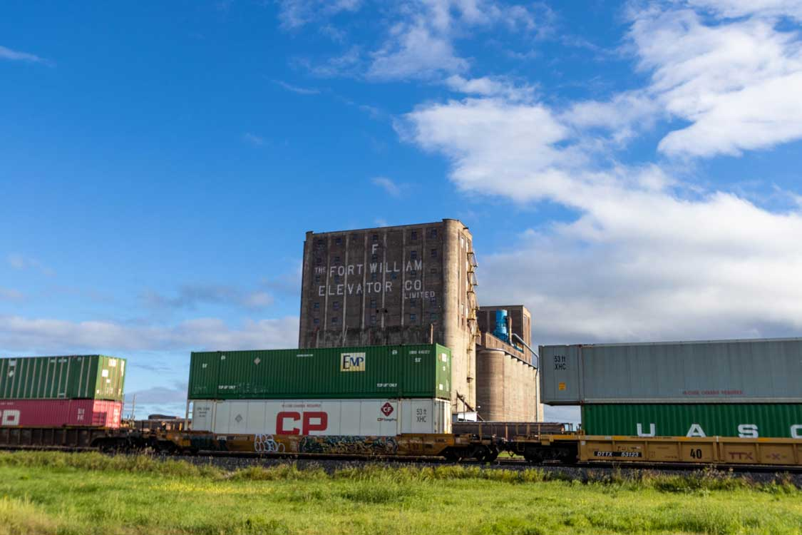 A Train in Front of a Grain Elevator in Thunder Bay Ontario